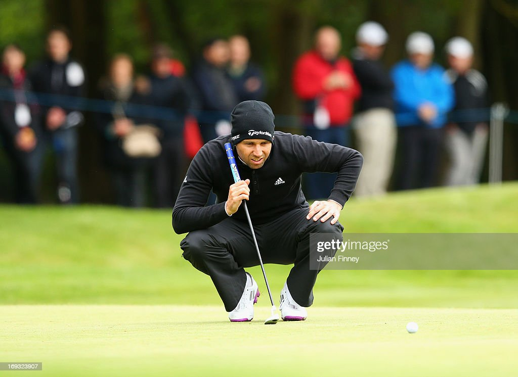 Sergio Garcia of Spain lines up a putt during the first round of the BMW PGA Championship on the West Course at Wentworth on May 23, 2013 in Virginia Water, England.