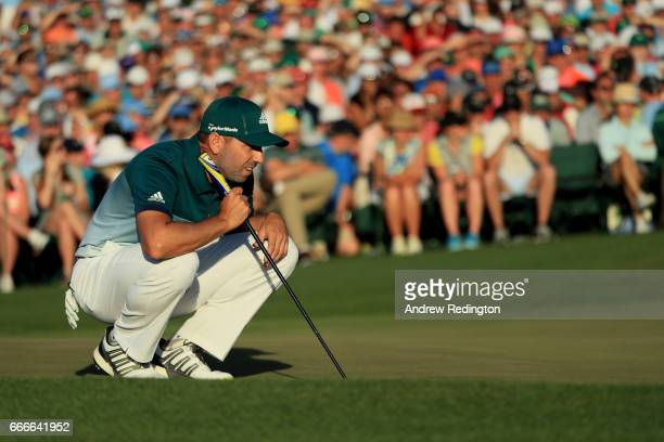 Sergio Garcia of Spain lines up a putt on the 18th hole during the final round of the 2017 Masters Tournament at Augusta National Golf Club on April...