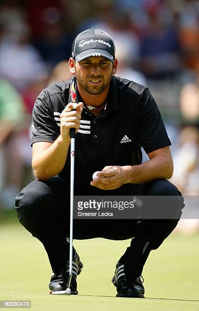 Sergio Garcia of Spain lines up a putt on the 5th hole during the final round of the Wyndham Championship at Sedgefield Country Club on August 23,...