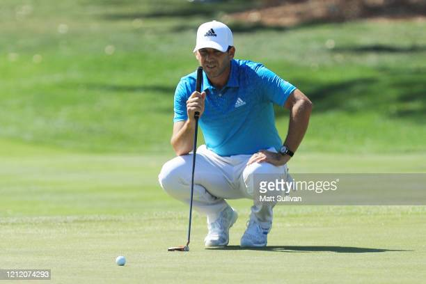 Sergio Garcia of Spain lines up a putt on the eighth green during the first round of The PLAYERS Championship on The Stadium Course at TPC Sawgrass...