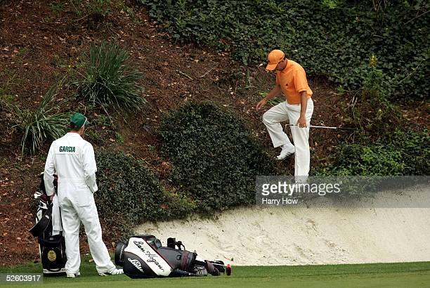 Sergio Garcia of Spain looks for his ball in the rough on the 12th hole during the first round of The Masters at the Augusta National Golf Club on...