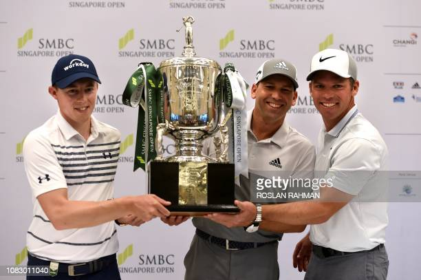 Sergio Garcia of Spain Matthew Fitzpatrick and Paul Casey of England pose with the trophy after a press conference ahead of the Singapore Open golf...