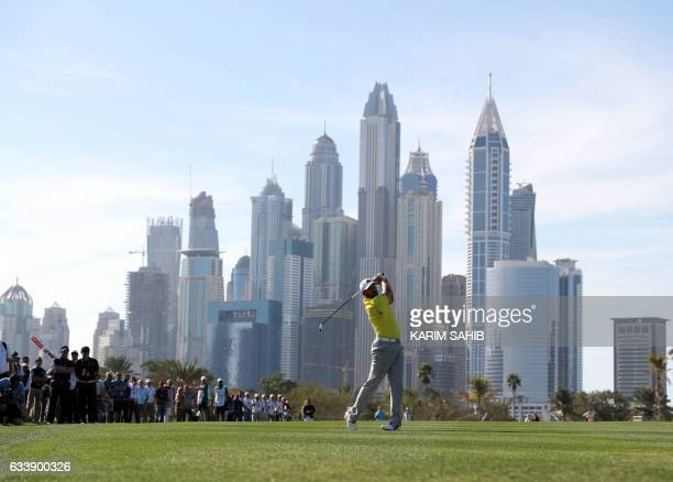 Sergio Garcia of Spain plays a shot during the final round of the Omega Dubai Desert Classic at the Emirates Golf Club on February 5 2017 in Dubai /...