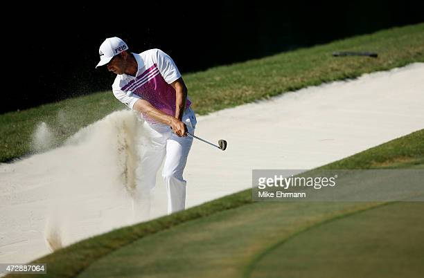 Sergio Garcia of Spain plays a shot from a bunker on the 11th hole during the final round of THE PLAYERS Championship at the TPC Sawgrass Stadium...