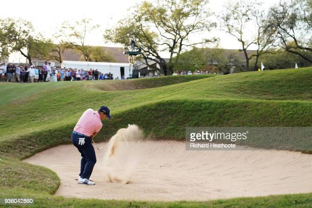 Sergio Garcia of Spain plays a shot from a bunker on the 18th hole during the first round of the World Golf ChampionshipsDell Match Play at Austin...