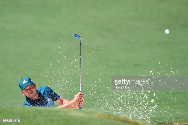 Sergio Garcia of Spain plays a shot from a bunker on the second hole during the final round of the 2017 Masters Tournament at Augusta National Golf...