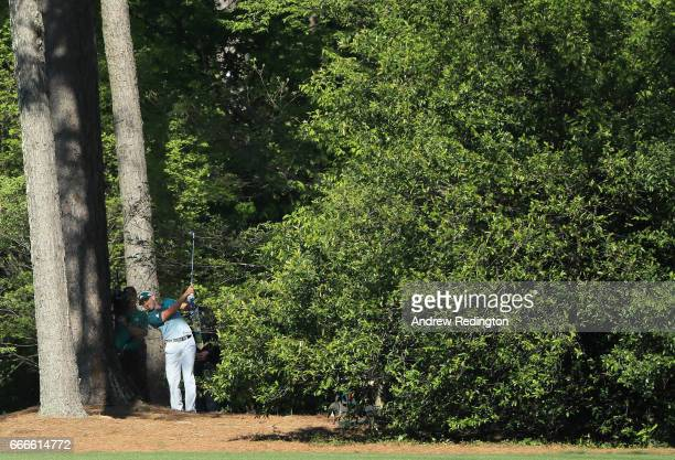 Sergio Garcia of Spain plays a shot from the pine needles on the 11th hole during the final round of the 2017 Masters Tournament at Augusta National...