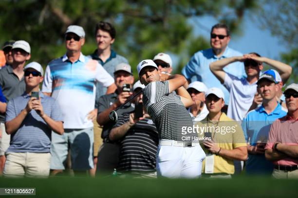 Sergio Garcia of Spain plays a tee shot as fans look o during a practice round prior to The PLAYERS Championship on The Stadium Course at TPC...