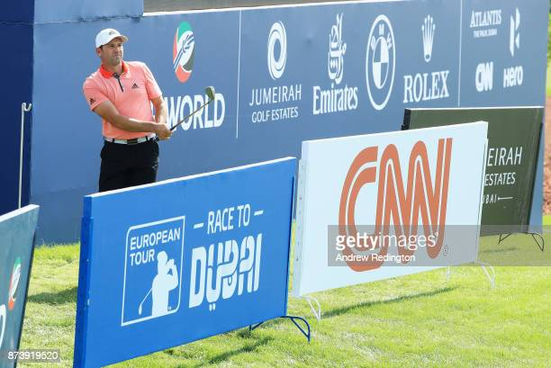 Sergio Garcia of Spain plays from behind the advertisement boards on the 18th hole during the ProAm prior to the DP World Tour Championship at...