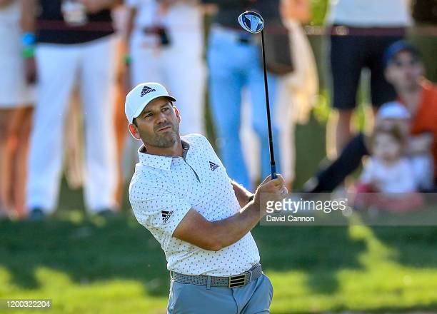 Sergio Garcia of Spain plays his second shot on the 18th hole during the third round of the Abu Dhabi HSBC Championship at Abu Dhabi Golf Club on...