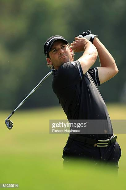 Sergio Garcia of Spain plays his second shot on the seventh hole during the final round of THE PLAYERS Championship on THE PLAYERS Stadium Course at...