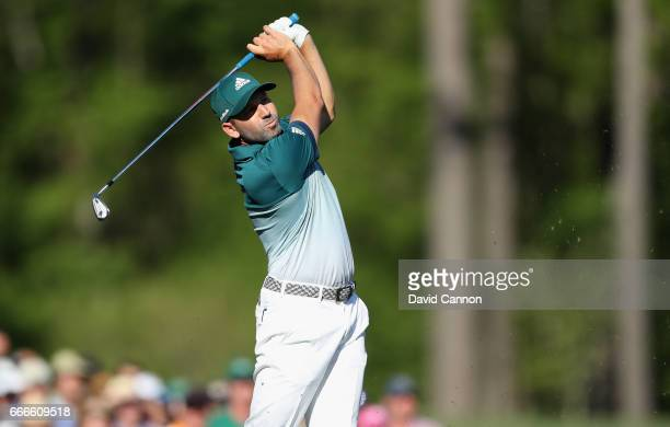 Sergio Garcia of Spain plays his shot from the 12th tee during the final round of the 2017 Masters Tournament at Augusta National Golf Club on April...