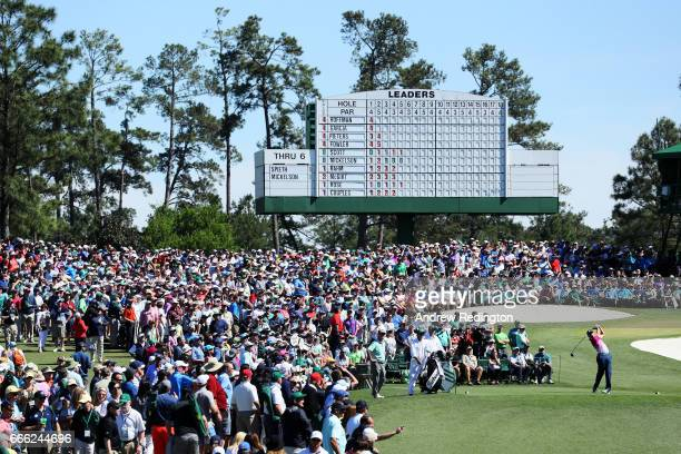 Sergio Garcia of Spain plays his shot from the third tee as a gallery of patrons look on during the third round of the 2017 Masters Tournament at...