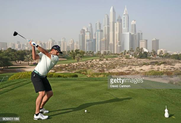 Sergio Garcia of Spain plays his tee shot from the eighth tee during the proam as a preview for the Omega Dubai Desert Classic on the Majlis Cours at...