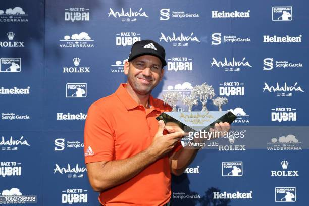 Sergio Garcia of Spain pose for a photo with the trophy after winning the tournament as the third round resumes play on day five of Andalucia...