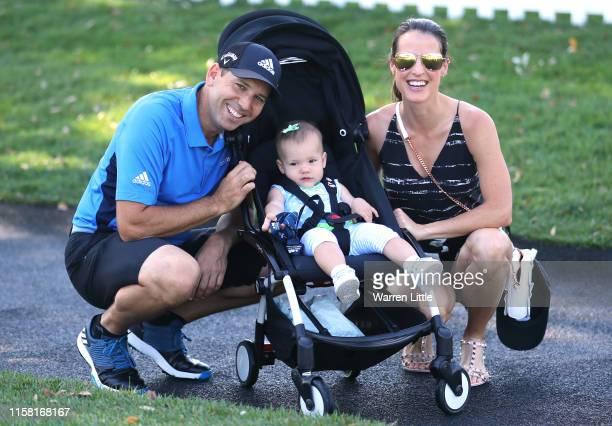 Sergio Garcia of Spain poses with his wife Angela Akins Garcia and daughter Azalea ahead of the Estrella Damm N.A. Andalucía Masters hosted by the...