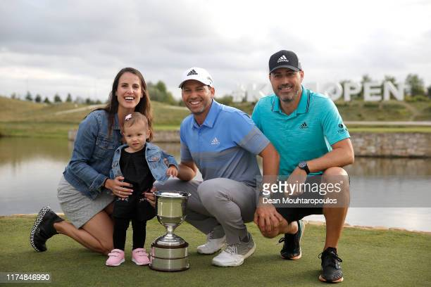 Sergio Garcia of Spain poses with his wife Angela Akins Garcia, daughter Azalea Adele Garcia and his brother Victor Garcia as he celebrates following...