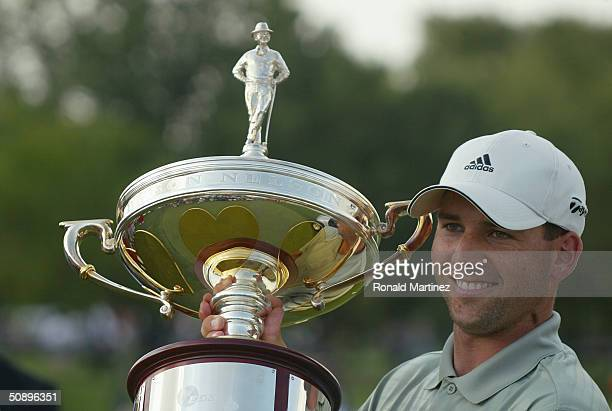 Sergio Garcia of Spain poses with the Byron Nelson trophy after winning the EDS Byron Nelson Championship on May 16 2004 at the TPC Las Colinas in...
