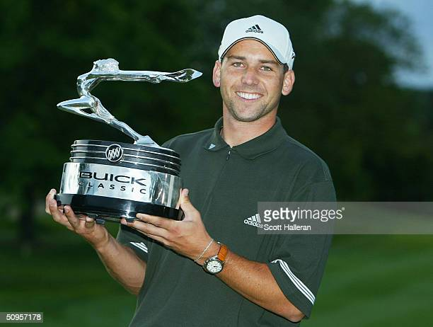 Sergio Garcia of Spain poses with the trophy after winning the Buick Classic on the third playoff hole agasint Rory Sabbatini at the Westchester...