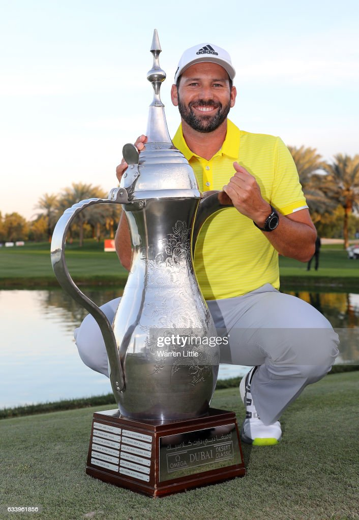 Sergio Garcia of Spain poses with the trophy after winning the final round of the Omega Dubai Desert Classic on the Majlis course at Emirates Golf Club on February 5, 2017 in Dubai, United Arab Emirates.