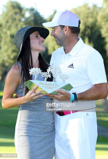 Sergio Garcia of Spain poses with the trophy and wife Angela Akins following his victory during the final round of of the Andalucia Valderrama...