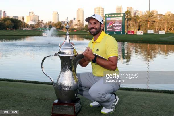 Sergio Garcia of Spain poses with the trophy following the final round of the Omega Dubai Desert Classic at the Emirates Golf Club on February 5 2017...