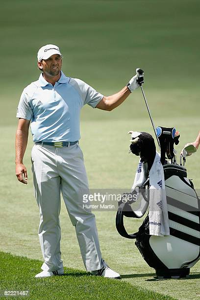 Sergio Garcia of Spain pulls a club from his bag to play his second shot on the first hole during round two of the 90th PGA Championship at Oakland...
