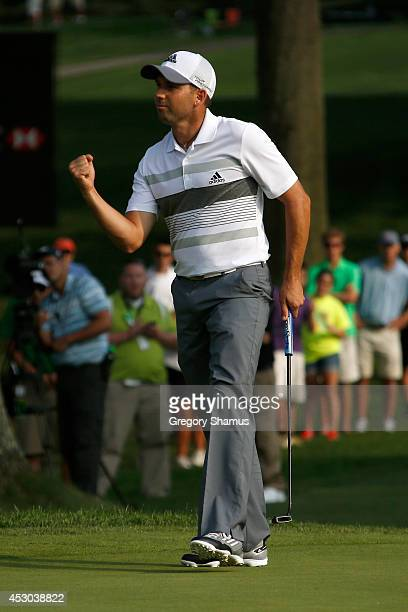 Sergio Garcia of Spain reacts after a birdie putt on the 18th green during the second round of the World Golf Championships-Bridgestone Invitational...