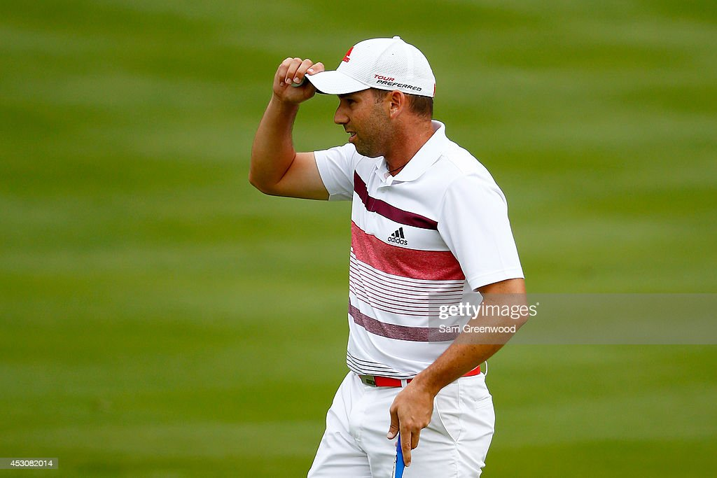 Sergio Garcia of Spain reacts after a putt on the 18th green during the third round of the World Golf Championships-Bridgestone Invitational at Firestone Country Club South Course on August 2, 2014 in Akron, Ohio.