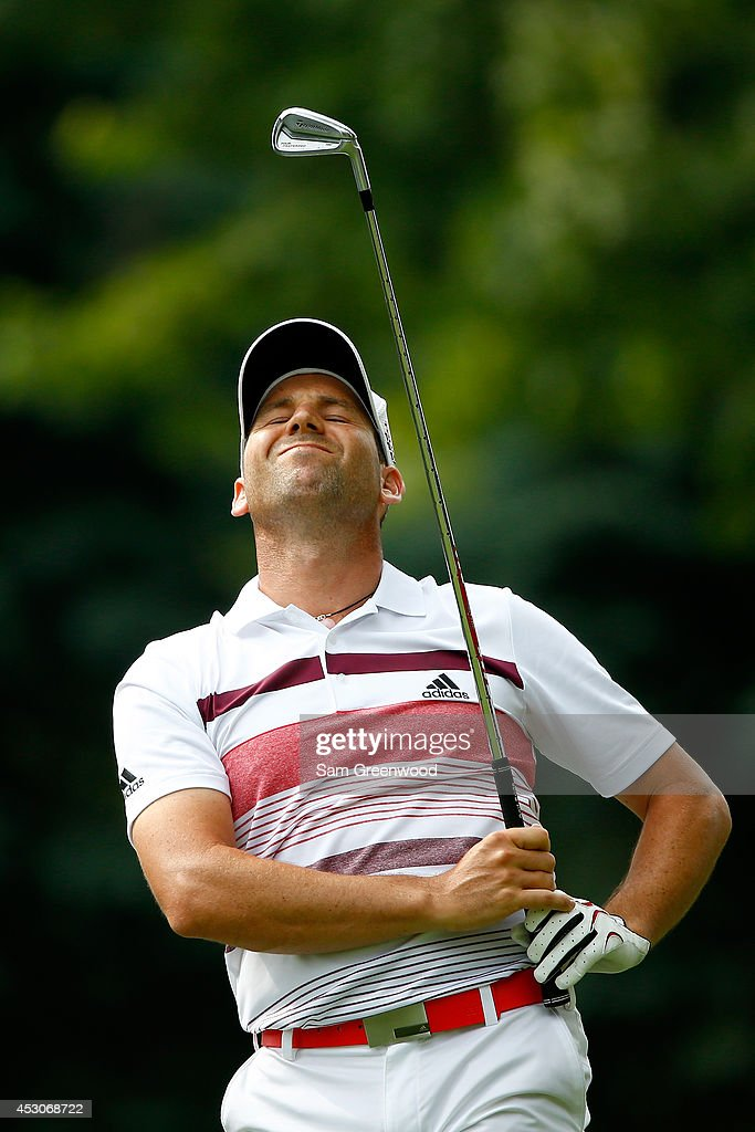 Sergio Garcia of Spain reacts after hitting off the seventh tee during the third round of the World Golf Championships-Bridgestone Invitational at Firestone Country Club South Course on August 2, 2014 in Akron, Ohio.