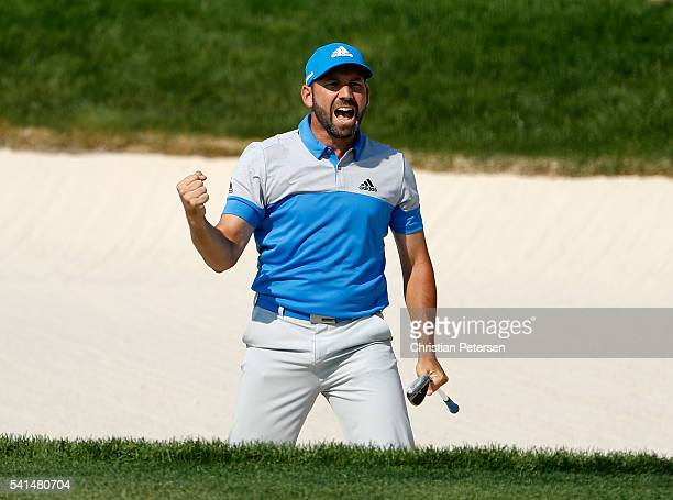Sergio Garcia of Spain reacts after holing a bunker shot for birdie on the eighth hole during the final round of the US Open at Oakmont Country Club...