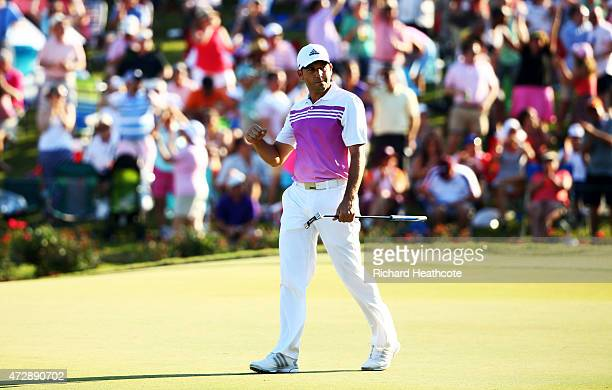 Sergio Garcia of Spain reacts after putting for birdie on the 17th green during the final round of THE PLAYERS Championship at the TPC Sawgrass...