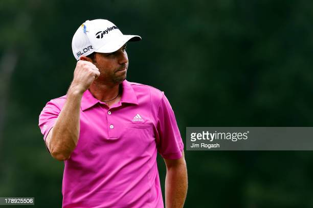 Sergio Garcia of Spain reacts after putting for eagle on the 18th green during the second round of the Deutsche Bank Championship at TPC Boston on...