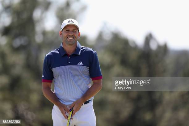 Sergio Garcia of Spain reacts after putting out on the 18th hole during the second round of the 2017 Masters Tournament at Augusta National Golf Club...
