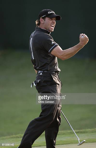 Sergio Garcia of Spain reacts after sinking a long par putt on during the final round of THE PLAYERS Championship on THE PLAYERS Stadium Course at...