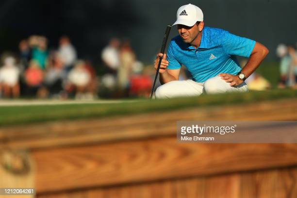 Sergio Garcia of Spain reacts reads a putt on the 17th green during the first round of The PLAYERS Championship on The Stadium Course at TPC Sawgrass...