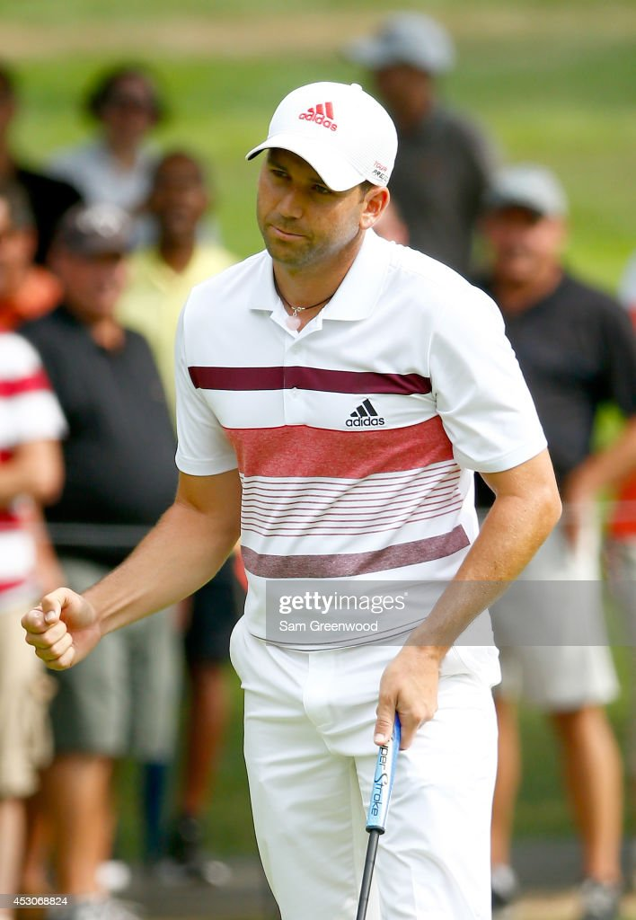 Sergio Garcia of Spain reacts to a birdie putt on the sixth green during the third round of the World Golf Championships-Bridgestone Invitational at Firestone Country Club South Course on August 2, 2014 in Akron, Ohio.