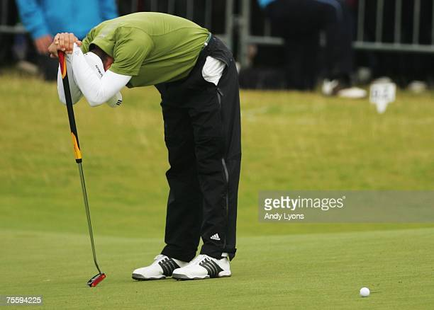 Sergio Garcia of Spain reacts to a missed par putt on the 18th green during the final round of The 136th Open Championship at the Carnoustie Golf...