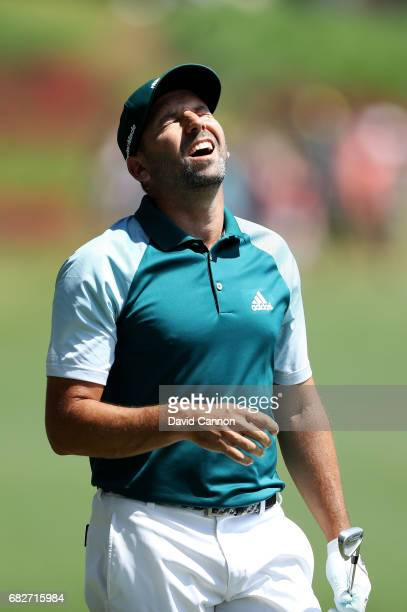 Sergio Garcia of Spain reacts to his second shot on the 18th hole during the third round of THE PLAYERS Championship at the Stadium course at TPC...