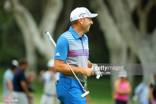 Sergio Garcia of Spain reacts to his second shot on the 9th hole during day one of the Estrella Damm N.A. Andalucia Masters hosted by the Sergio...
