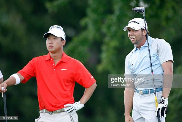 Sergio Garcia of Spain reacts to his tee shot on the 14th hole while Anthony Kim watches during round two of the 90th PGA Championship at Oakland...