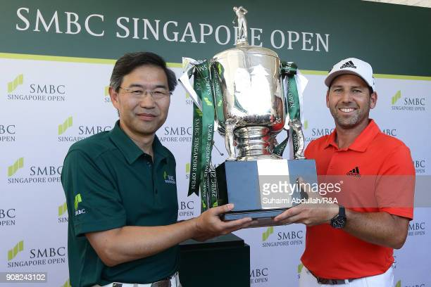 Sergio Garcia of Spain receives the trophy from Shosuke Mori Senior Managing Executive Officer Sumitomo Mistui Banking Corporation after winning the...