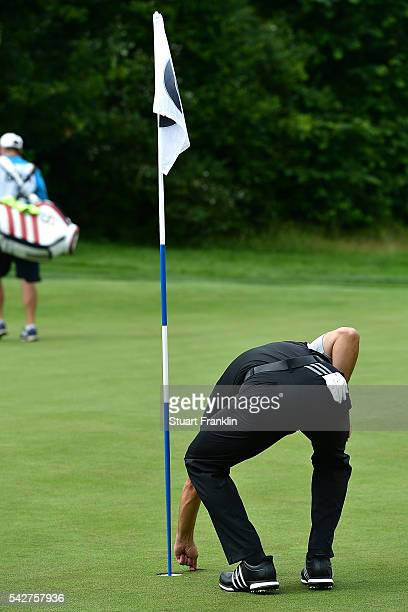 Sergio Garcia of Spain removes his ball from the cup after his hole in one on the 11th hole during the second round of the BMW International Open at...