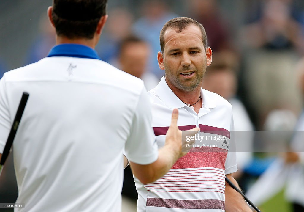 Sergio Garcia of Spain shakes hands with Justin Rose of England on the 18th green during the third round of the World Golf Championships-Bridgestone Invitational at Firestone Country Club South Course on August 2, 2014 in Akron, Ohio.