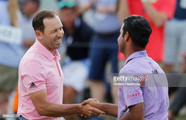 Sergio Garcia of Spain shakes hands with Shubhankar Sharma of India on the 18th green after defeating him 1up during the first round of the World...