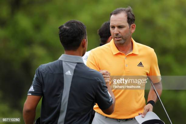 Sergio Garcia of Spain shakes hands with Xander Schauffele of the United States after defeating him 31 on the 17th green during the third round of...