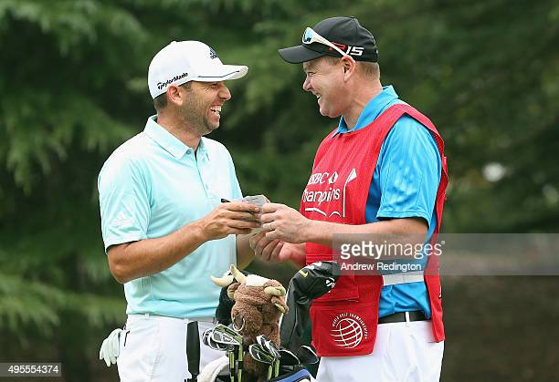 Sergio Garcia of Spain shares a joke with his caddie Glen Murray on the first hole during the Pro Am event prior to the start of the WGC HSBC...
