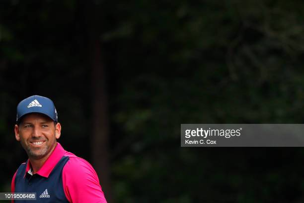 Sergio Garcia of Spain shares a smile on the second tee during the final round of the Wyndham Championship at Sedgefield Country Club on August 19,...