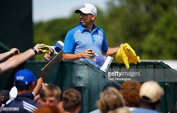 Sergio Garcia of Spain signs autographs during a practice round prior to the start of The 143rd Open Championship at Royal Liverpool on July 15 2014...