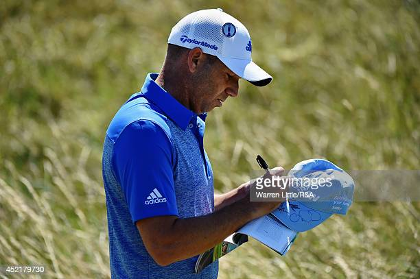 Sergio Garcia of Spain signs his autograph during a practice round prior to the start of The 143rd Open Championship at Royal Liverpool on July 15...